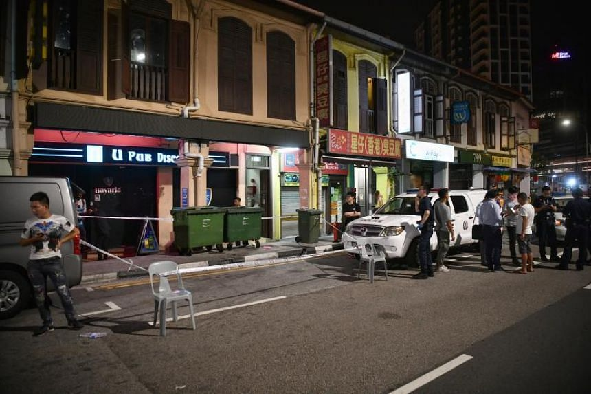Police at the incident site in Geylang Lorong 39 on Aug 30. A 53-year-old man, known to the police and wanted by the Central Narcotics Bureau, was identified within an hour of the incident using images from police cameras.
