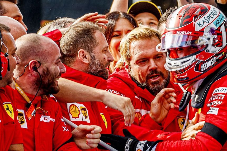 Charles Leclerc (right) celebrates with team members after winning the Belgian Grand Prix on Sept 1, 2019.