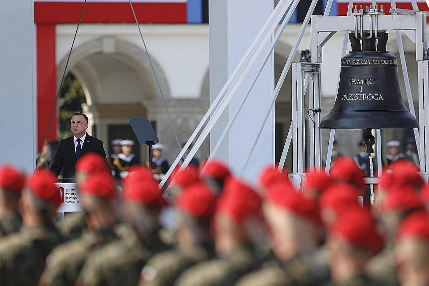 Polish President Andrzej Duda speaking at a ceremony marking the 80th anniversary of the start of World War II in Warsaw yesterday. PHOTO: ASSOCIATED PRESS