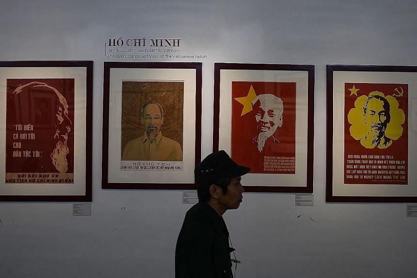 Posters of Vietnam's revolutionary leader Ho Chi Minh at the Ho Chi Minh Museum in Hanoi. Protecting Ho's embalmed body is the ultimate patriotic service for the guards at his tomb in Hanoi, a monolithic shrine to a man who still pervades public life