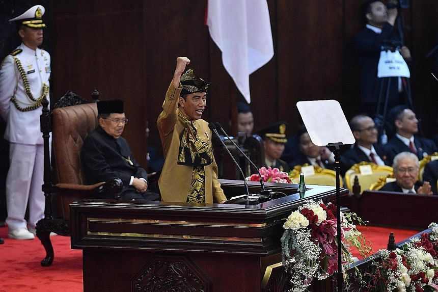 President Joko Widodo, seen here delivering a speech in Parliament on Aug 16, was one of only two contenders in the bitterly fought elections in 2014 and this year. Indonesia's restrictive election law has been blamed for the low number of candidates
