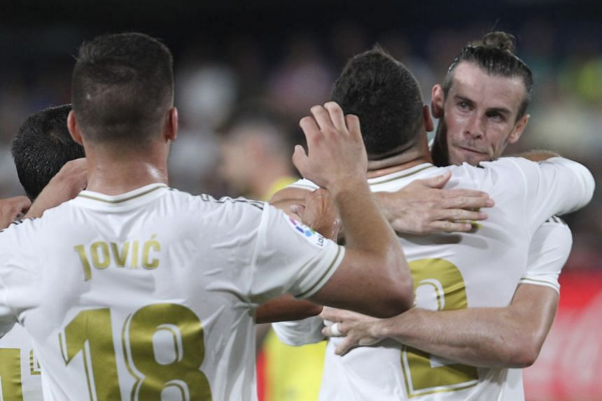 Bale (far right) celebrates after scoring against Villarreal.