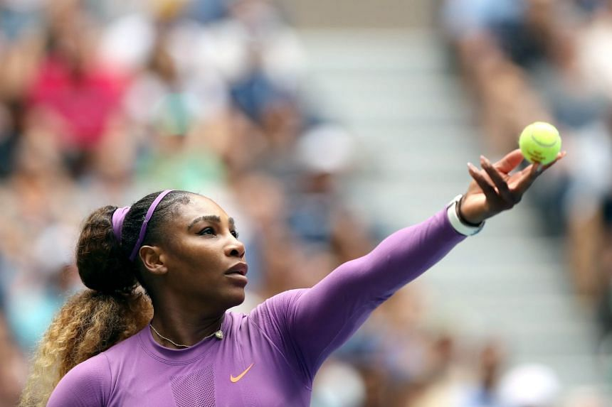 Williams serves during her match against Petra Martic of Croatia.