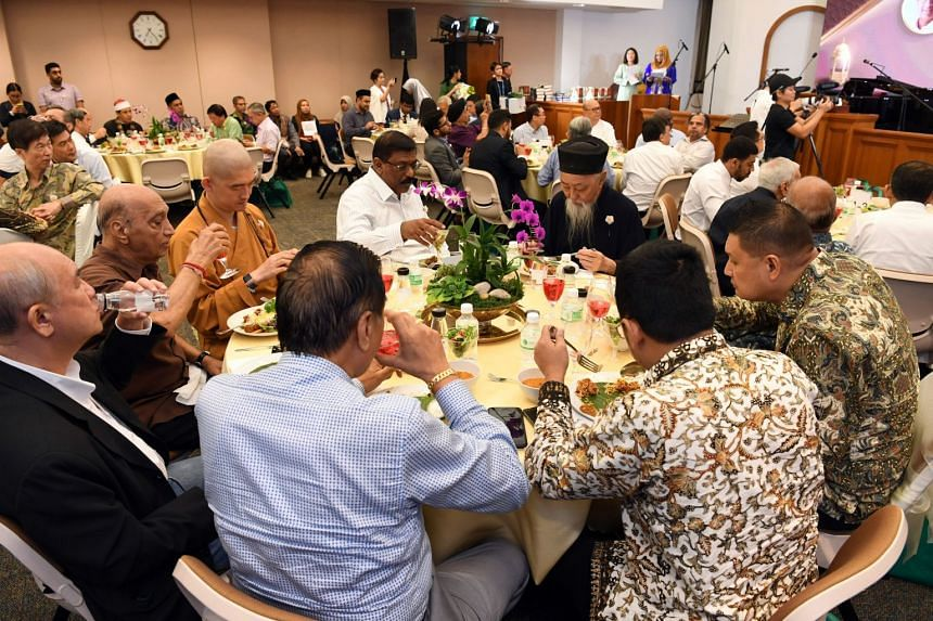 Members of the Muslim and Christian communities as well as grassroots and religious leaders of various faiths share an iftar meal at the Church of Jesus Christ of Latter-Day Saints in Bukit Timah Road during Ramadan, on May 27, 2019.