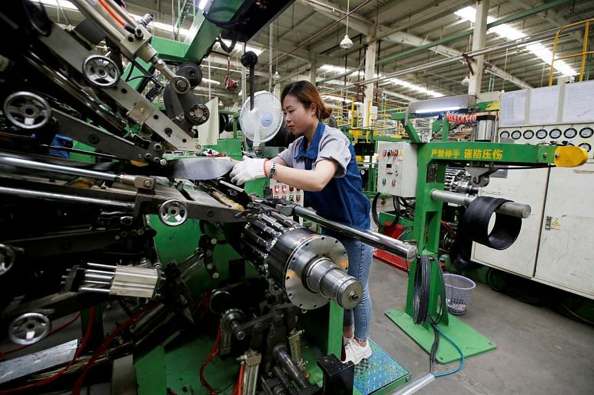 An employee works on the production line of a tyre factory under Tianjin Wanda Tyre Group, which exports its products to countries such as US and Japan, in Xingtai, Hebei province, China, on May 21, 2019.