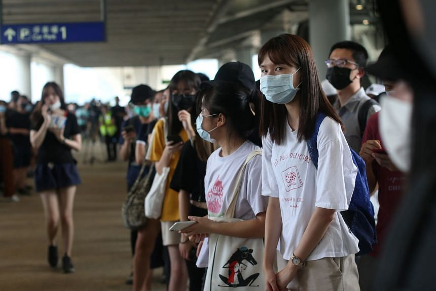 Protesters gathering on a walkway during rally at Hong Kong International Airport, on Sept 1, 2019.