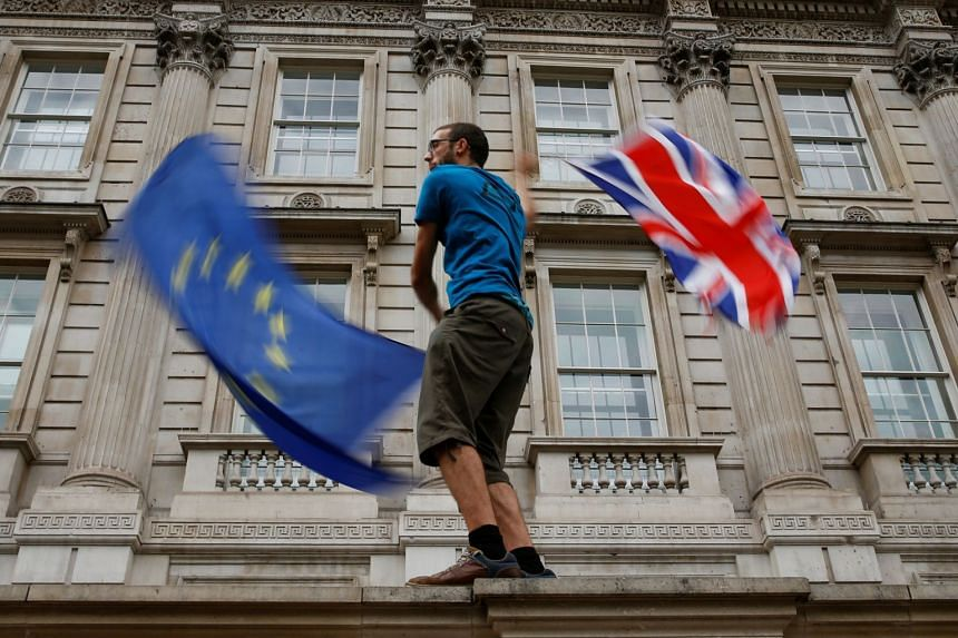 An anti-Brexit protester demonstrating at Whitehall in London on Saturday. The Labour Party's Mr Keir Starmer said that the proposed legislation would force an extension of the Brexit deadline, though he did not say exactly how.