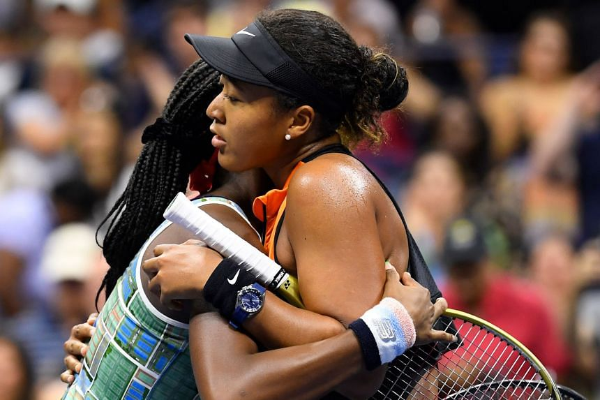A touching moment at the net for Japanese world No. 1 Naomi Osaka and 15-year-old American sensation Coco Gauff after their third-round match at the US Open on Saturday. Two-time Grand Slam champion Osaka won 6-3, 6-0. PHOTO: EPA-EFE