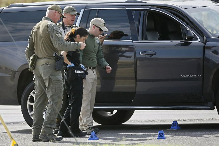 Law enforcement officials process a scene involved in the shooting in Odessa, Texas.