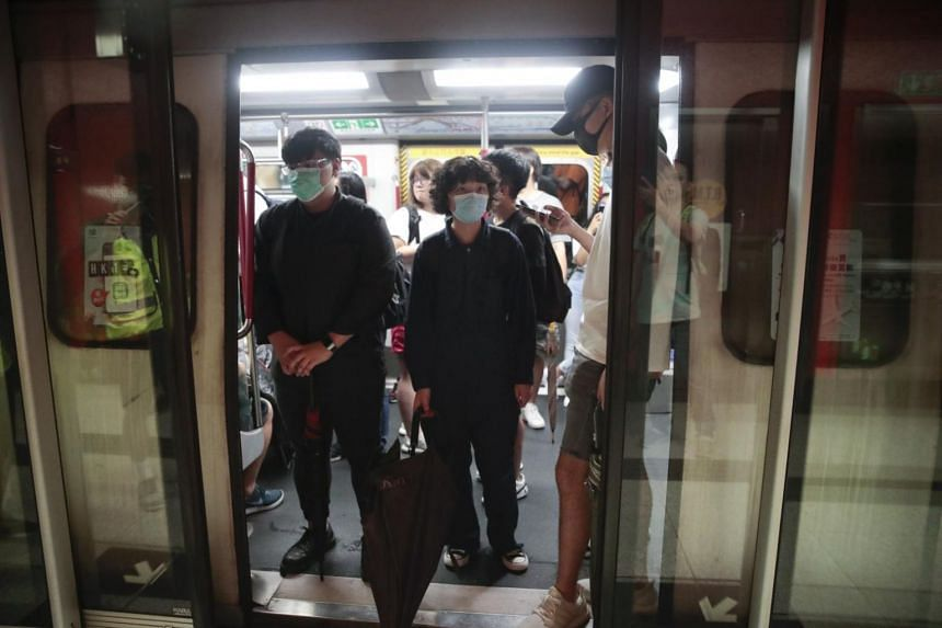 Protesters wearing masks occupy a train car at a subway station in Hong Kong on Sept 2, 2019.