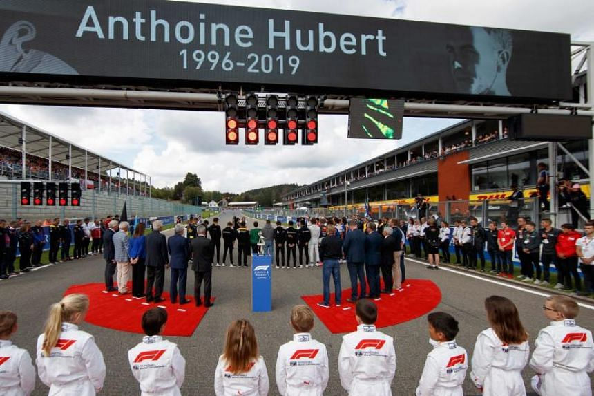 Drivers and team members observe a minute's silence for late French driver Anthoine Hubert, who died in an accident during a Formula Two race, before the start of the Belgian Formula One Grand Prix in Spa on Sept 1, 2019.