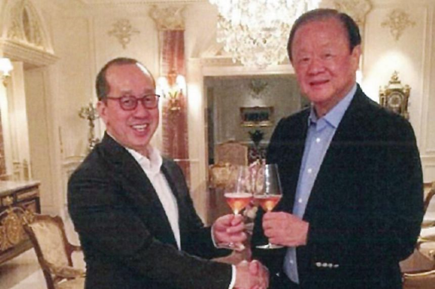 Raffles Education chairman Chew Hua Seng (left) and tycoon Oei Hong Leong toasting champagne in an undated photo that was included in court documents.