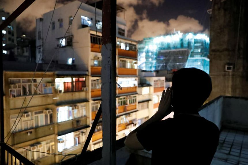 Mr Choco Chu, 23, shouts slogans from his rooftop in Sham Shui Po in Hong Kong on Aug 29, 2019.