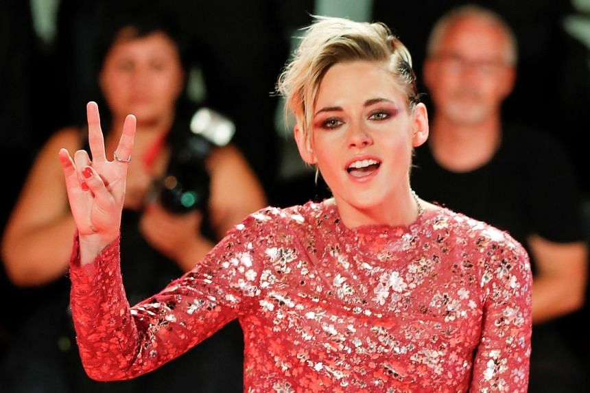Kristen Stewart poses.on the red carpet at the 76th Venice Film Festival.