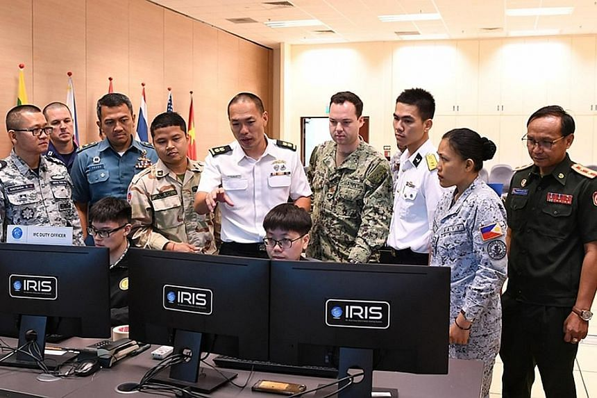 Participants in the Asean-US Maritime Exercise using the Republic of Singapore Navy's Information Fusion Centre Real-time Information-sharing System at the Changi Command and Control Centre yesterday.