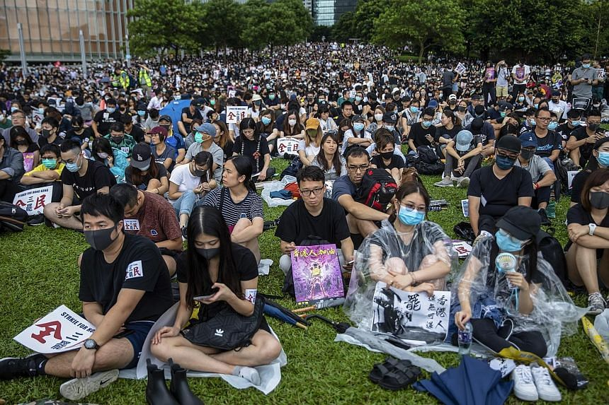 Student protesters dressed in black at Chinese University of Hong Kong during a class boycott yesterday. The city's students say they would give the government two weeks to respond to their demands for greater democracy before further escalating thei