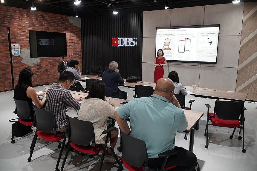 Ms Evy Wee, DBS' head of financial planning and personal investing, at the media briefing on digiPortfolio yesterday. The hybrid human-robo investment platform will be available to retail investors with at least $1,000 to invest, allowing them to buy