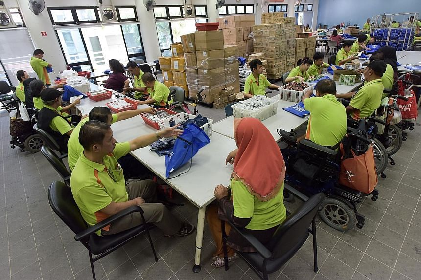 In this photo taken on Aug 30 last year, people from the SPD - the former Society for the Physically Disabled - packing bags for The Straits Times Run. The Ministry of Manpower's annual Comprehensive Labour Force Survey found that community, social a
