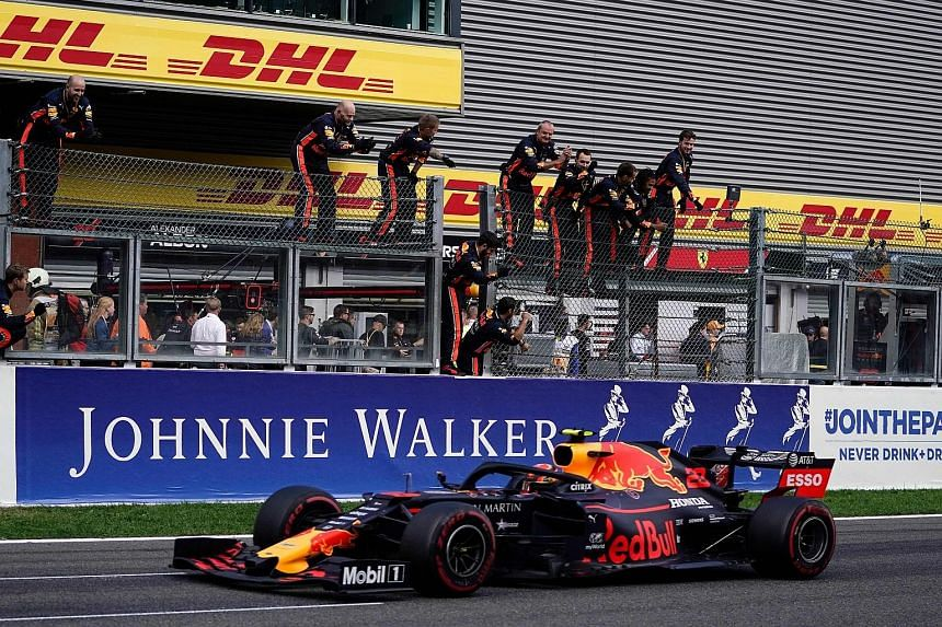 Alexander Albon is cheered on by Red Bull team members as he finishes fifth in the Belgian Grand Prix, the Thai driver's first race since his promotion from Toro Rosso. PHOTO: AGENCE FRANCE-PRESSE