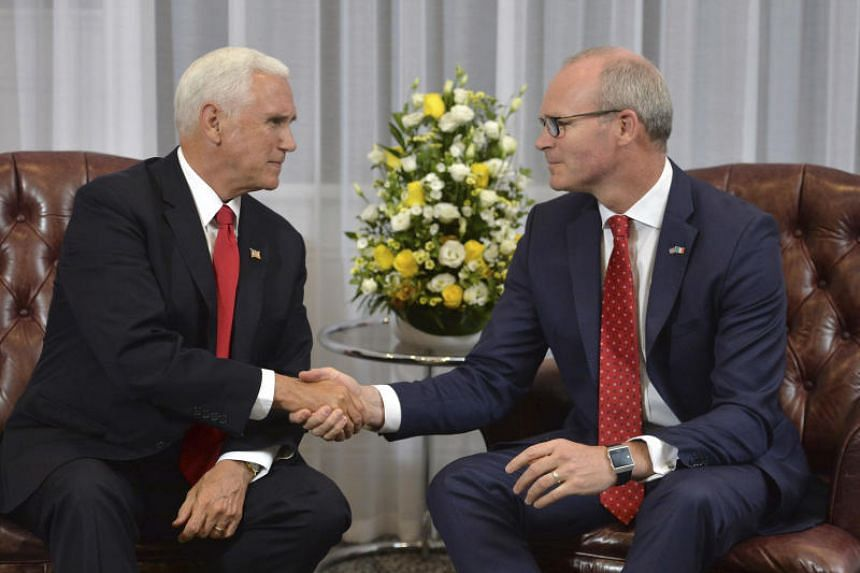 Ireland's Foreign Minister Simon Coveney (right) shakes hands with with US Vice-President Mike Pence during their meeting, after he arrived at Shannon airport for the start of an official visit to Ireland on Sept 2, 2019.