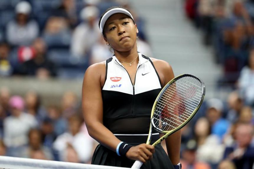 Naomi Osaka of Japan reacts during her Women's Singles fourth round match against Belinda Bencic of Switzerland on day eight of the 2019 US Open.