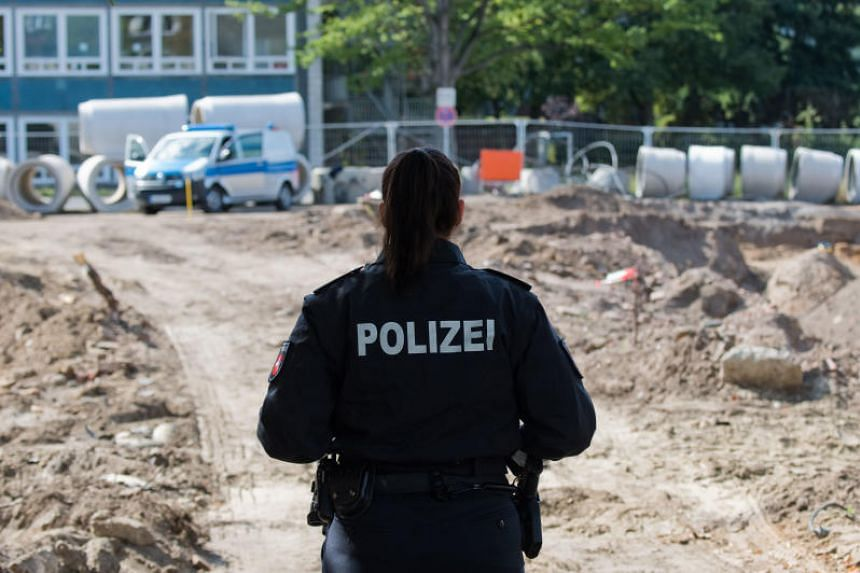 A policewoman secures an access to a construction site in the Zoo District in Hanover, northern Germany on Sept 2, 2019, after the discovery of a bomb dating from World War II.