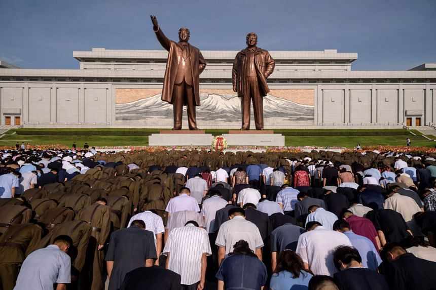Visitors paying their respects on Mansu Hill in Pyongyang. Singapore does not have diplomatic representation in North Korea and the MFA is unable to provide consular help to Singaporeans there if things go wrong.