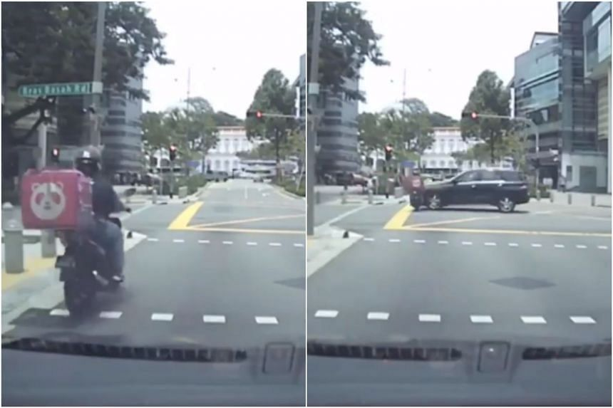 In the video, the rider can be seen not stopping despite the traffic light being red. A black car crashes into him from his right as he is about halfway across the junction.