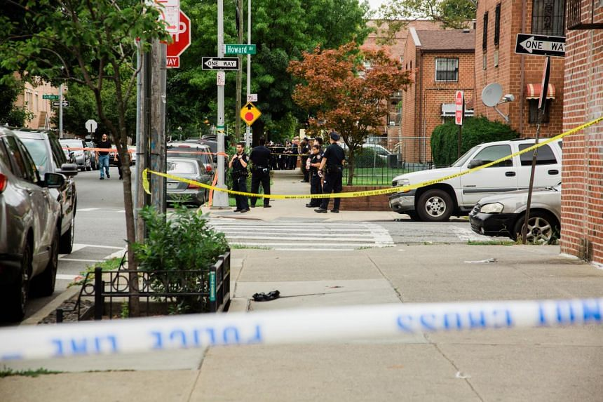Police officers on the scene of a fatal shooting near the intersection of Howard Avenue and Dumont Avenue in Brooklyn on Sept 2, 2019.