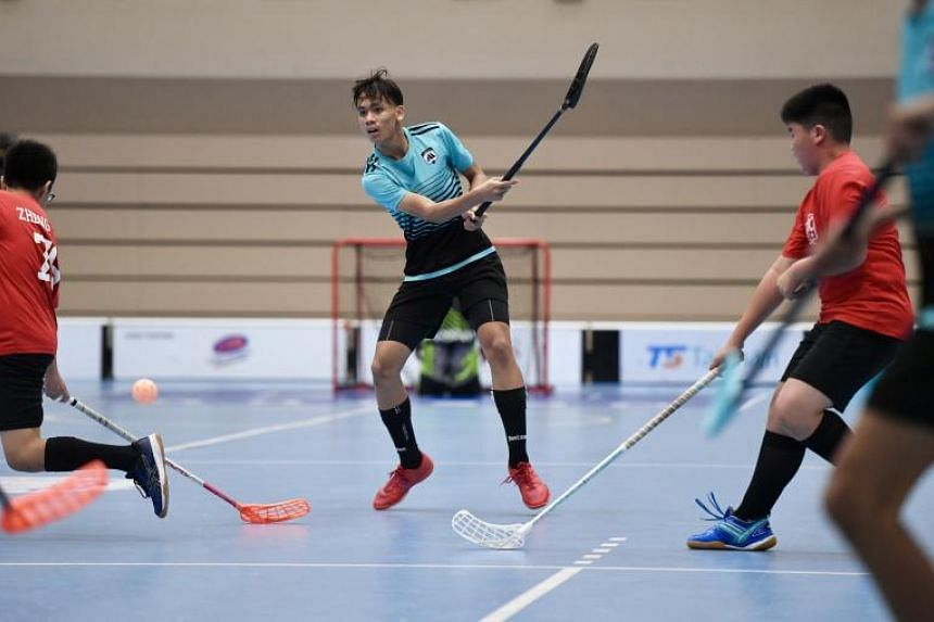 Meridian Secondary's Muhammad Danish Arshaq bin Sharin scores the first goal for his team during the Schools National C Division boys' floorball final against Catholic High School on Sept 3, 2019.