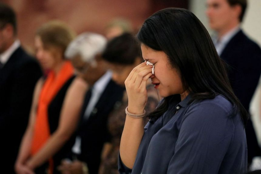 A family member reacts during a commemoration ceremony for MH17 victims in Kuala Lumpur.