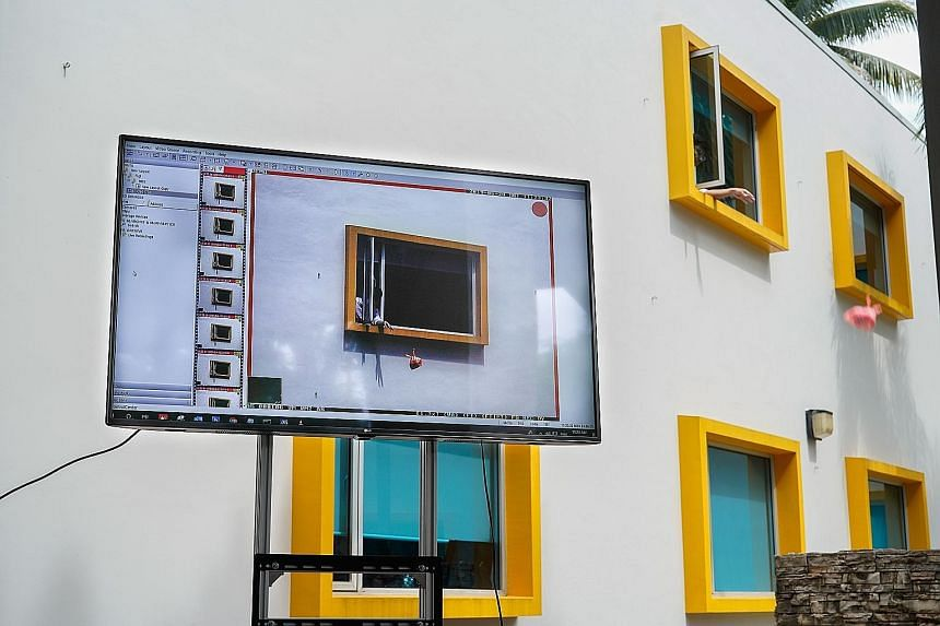 A demonstration of how the National Environment Agency's surveillance cameras can capture someone throwing rubbish out of the window. The cameras helped catch more than 2,200 high-rise litterbugs between August 2012 and December last year, of whom 52