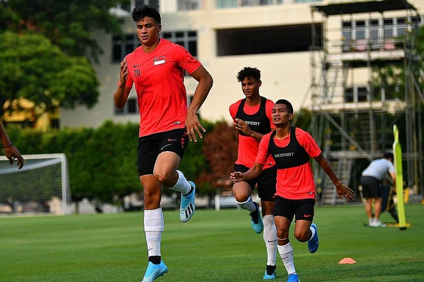 Ikhsan Fandi (left) headed straight for Lions training at the Geylang Lorong 12 field after touching down yesterday afternoon at Changi. ST PHOTO: LIM YAOHUI