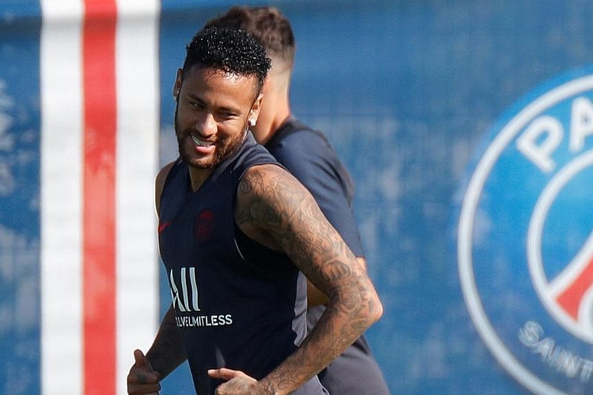 Unsettled star Neymar will remain at Paris Saint-Germain at least until January when the transfer window reopens. The 27-year-old Brazilian is seeking a return to Barcelona and has been linked with Real Madrid. PHOTO: REUTERS