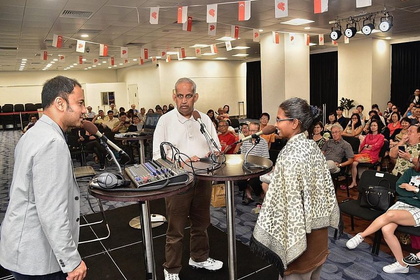 Mr Ernest Luis (far left), head of SPH podcast productions, recording a podcast on stage with Mr R. Jayakumar, a management consultant, and Ms Kamilah Mohamed Anverdeen, a hotel employee, both members of the audience.