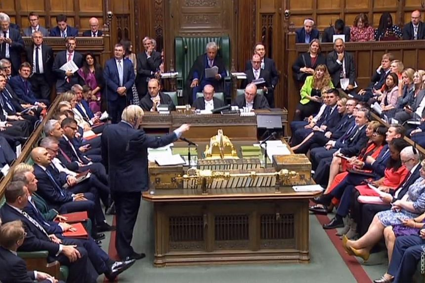 British Prime Minister Boris Johnson speaking in the House of Commons yesterday, as he faced a showdown with MPs who aimed to take control of the agenda to stop a no-deal Brexit. PHOTO: EPA-EFE