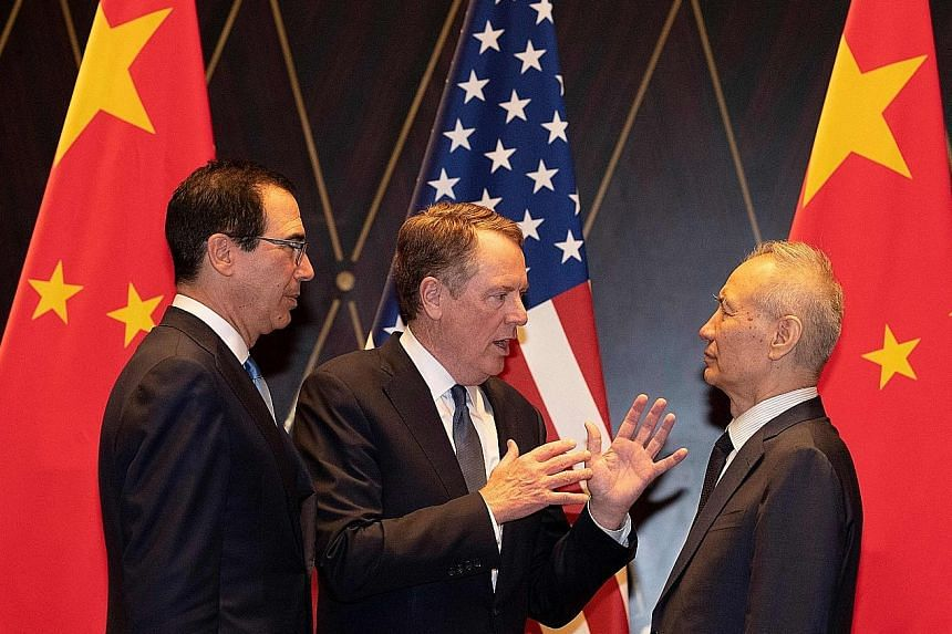 From left: US Treasury Secretary Steve Mnuchin, US Trade Representative Robert Lighthizer and Chinese Vice-Premier Liu He at a meeting in Shanghai in July. PHOTO: AGENCE FRANCE-PRESSE
