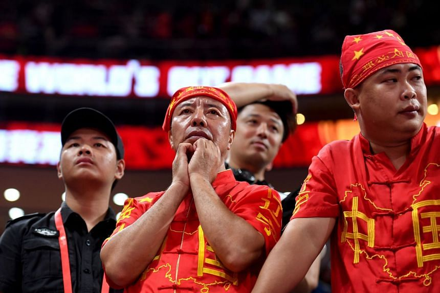 China's fans look on after China lost against Venezuela.