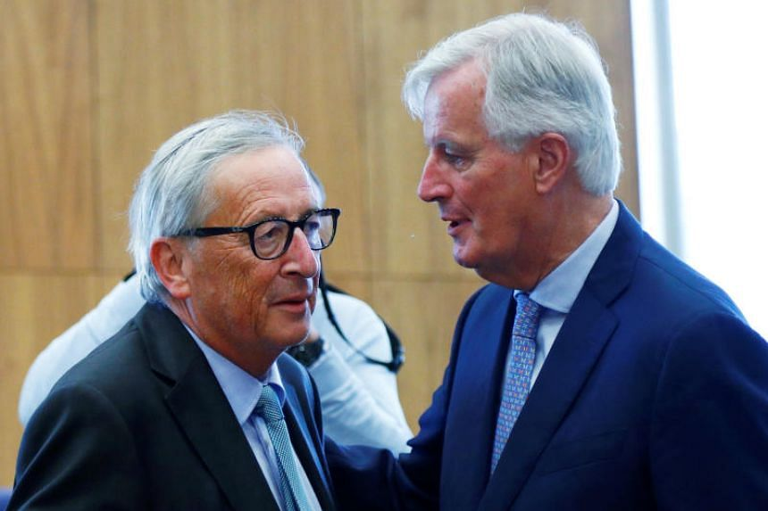 European Commission President Jean-Claude Juncker (left) greets EU's chief Brexit negotiator Michel Barnier during a college meeting of the EU executive in Brussels on Sept 4, 2019.