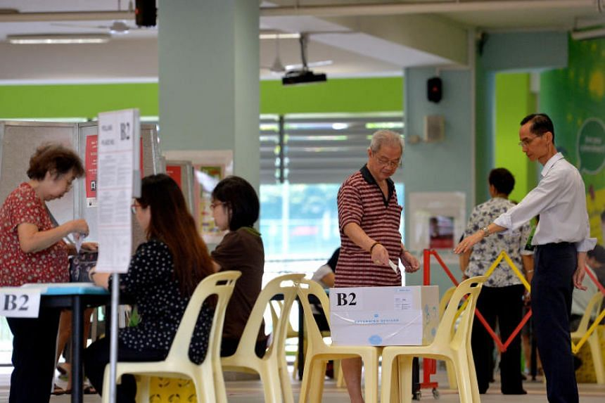 Voters casting their votes at the polling station in Cantonment Primary School during Singapore's general election on Sept 11, 2015.