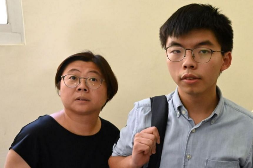 Leading Hong Kong pro-democracy activist Joshua Wong (right) with Chen Min (left), secretary general of Taiwan's opposition New Power Party in Taipei on Sept 3, 2019.