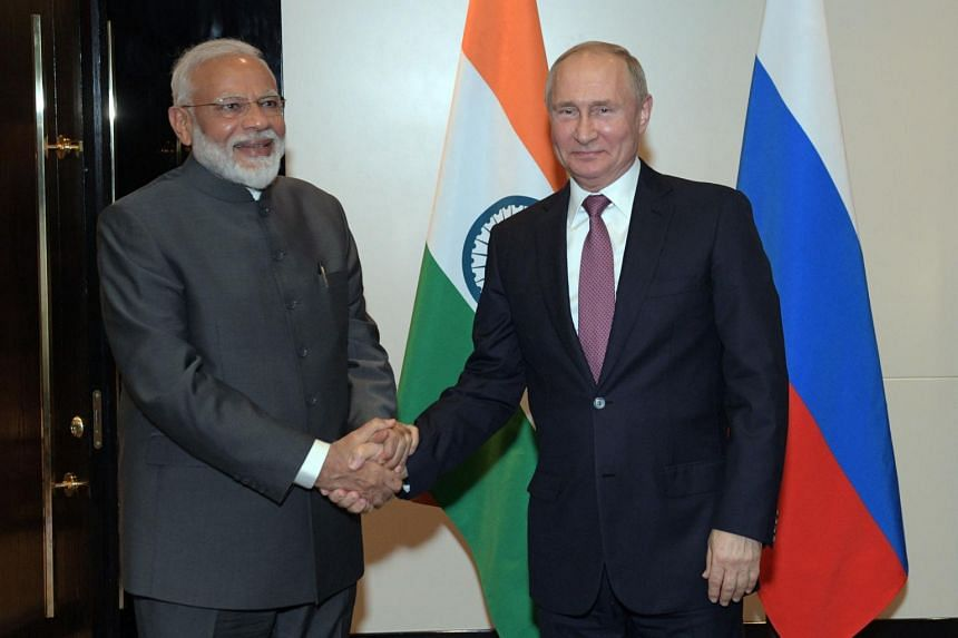 In this photo taken on June 13, 2019, Russian President Vladimir Putin meets with Indian Prime Minister Narendra Modi on the sidelines of the Shanghai Cooperation Organisation summit.