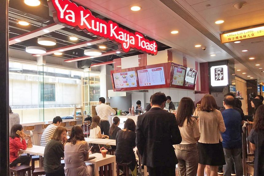 Ya Kun's outlet in Hong Kong's Admiralty financial district on its opening day in June. Sales at the outlet have been below expectations, says Ya Kun executive chairman Adrin Loi, but business is still holding up during the week, thanks to the Admira