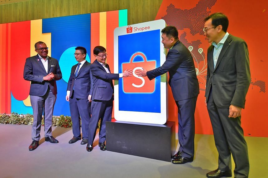 Deputy Prime Minister Heng Swee Keat (centre) and Sea group chief executive and chairman Forrest Li officially opening Shopee's new regional headquarters yesterday, accompanied by (from far left) Digital Industry Singapore chief digital industry of