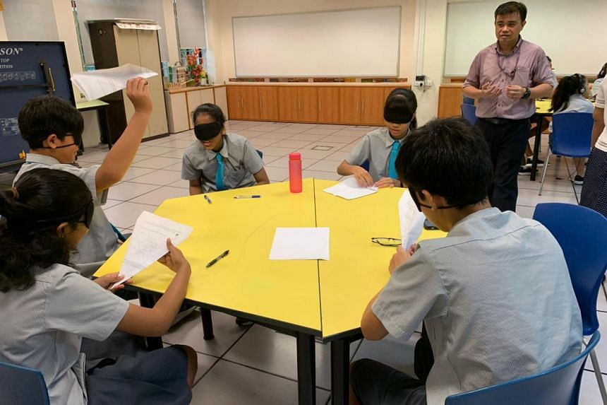 Bowen Secondary teacher Alvin Chong facilitating a lesson to help students in a mixed-stream class develop empathy for people who are visually disabled.