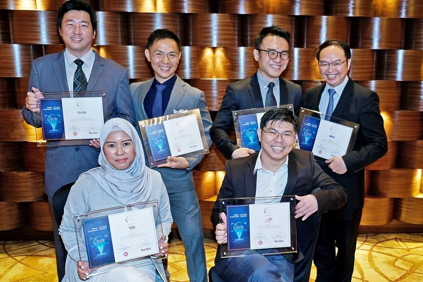 Representatives of firms recognised at the Singapore Prestige Brand Award yesterday included (front row) Mrs Mariana Eunos from Wedding by LQ and Mr Michael Lee, director of Nan Hwa Chong (Ah Chew) Fish-Head Steamboat Corner; and (back row, from left