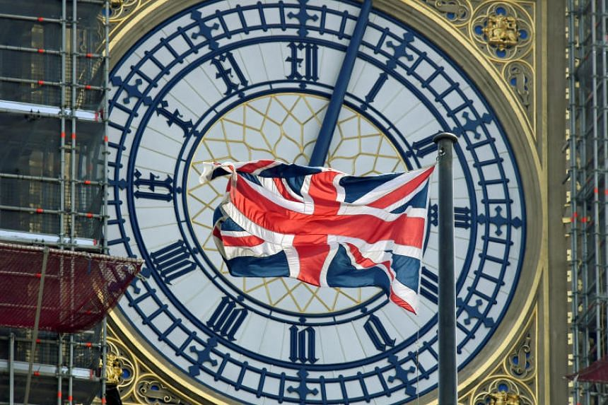 The British Union Jack flag flies in front of the clock face of Big Ben in London on Aug 29, 2019.