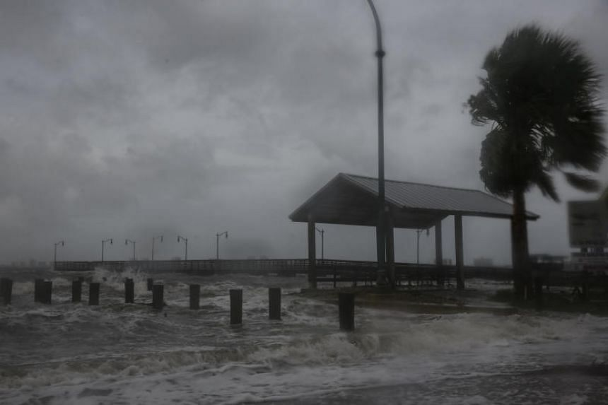 Strong gusts of wind and bands of heavy rain cover a pier at the Jensen Beach Causeway Park in Florida on Sept 3, 2019, as Hurricane Dorian churned towards the south-eastern coast of the US.