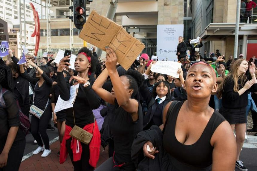People demonstrate outside The Cape Town International Convention Centre, where the World Economic Forum Africa meeting is held, on Sept 4 to protest against the abuse of women by men.