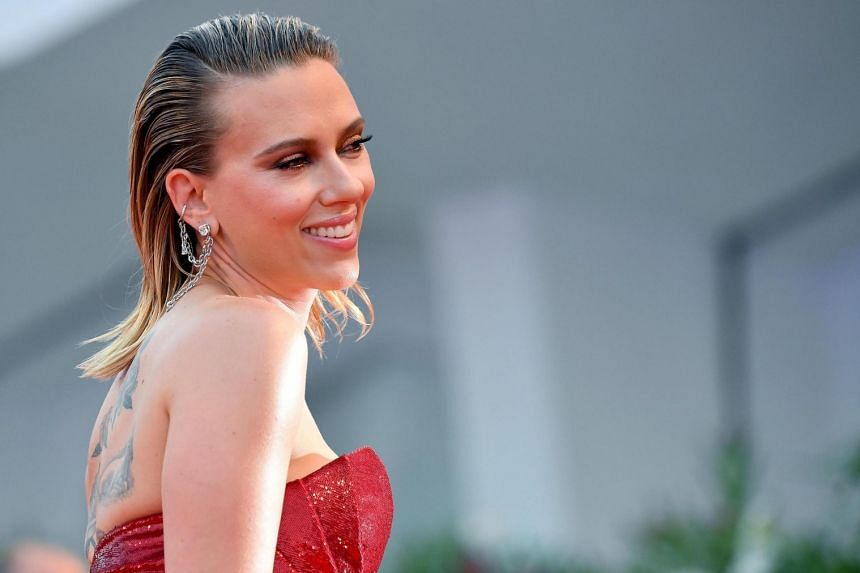 Johansson poses for photographers at the premiere of Marriage Story'during the Venice film festival,